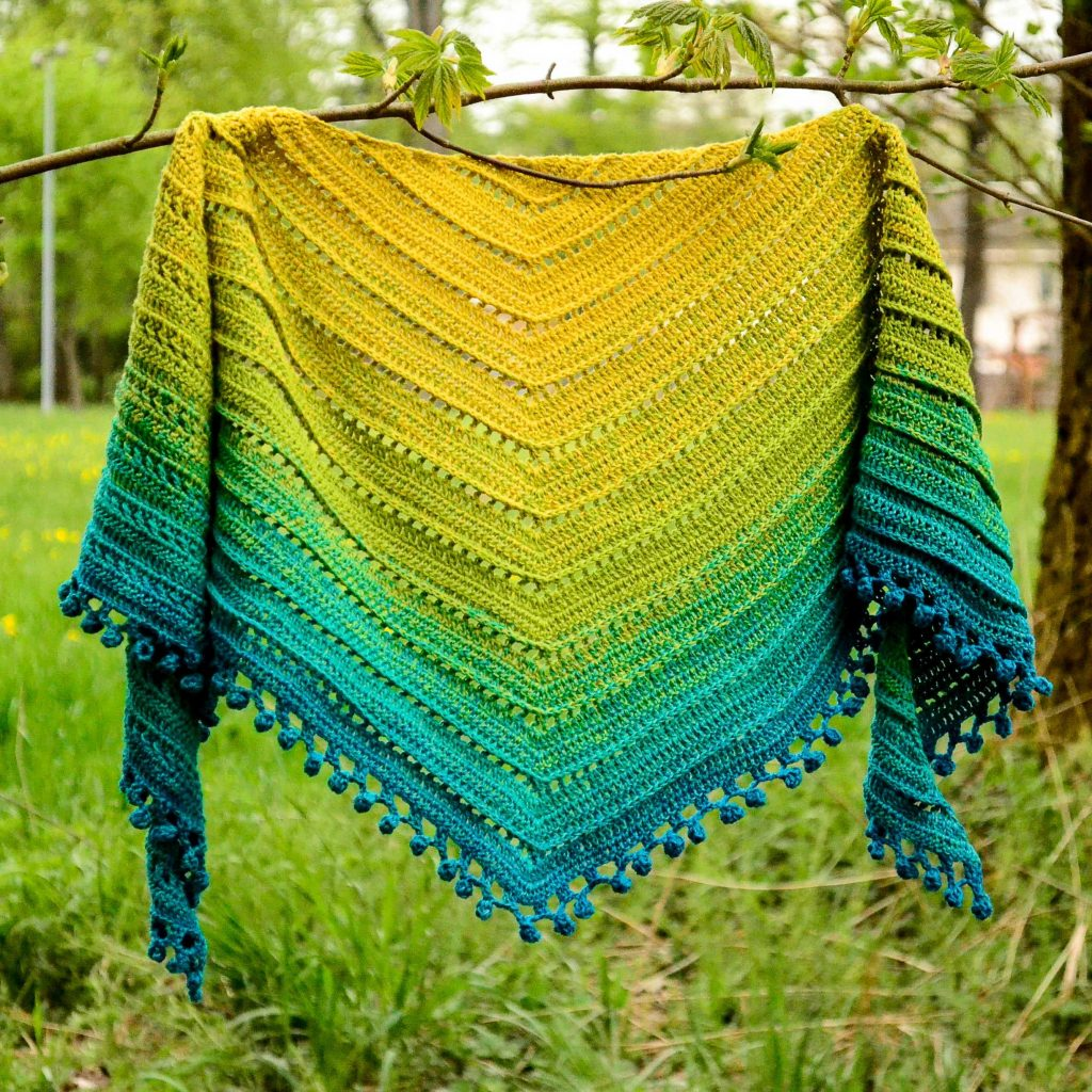 Gooseberry marmalade shawl on a branch, showing the beautiful curling of the sides