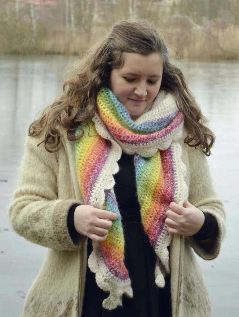 Crochet rainbow shawl worn as a regular scarf, wrapped around the neck, with the colors overlapping