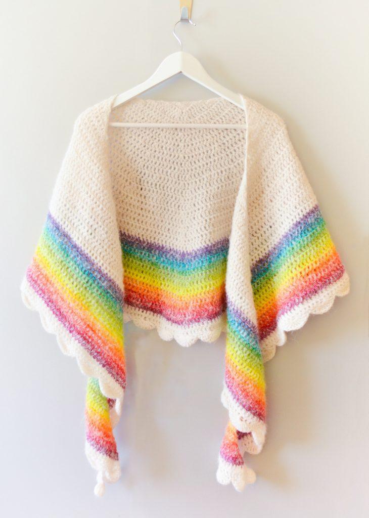 Rainbow shawl on a coat hanger