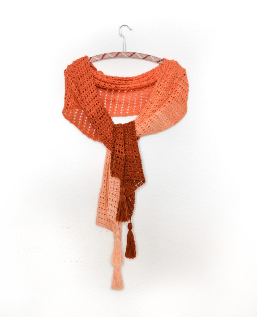 Imperial topaz easy tunisian crochet lace pattern - sample on a hanger with a knot