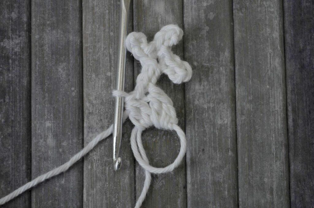 Easy snowflake crochet pattern yarnandy step 9