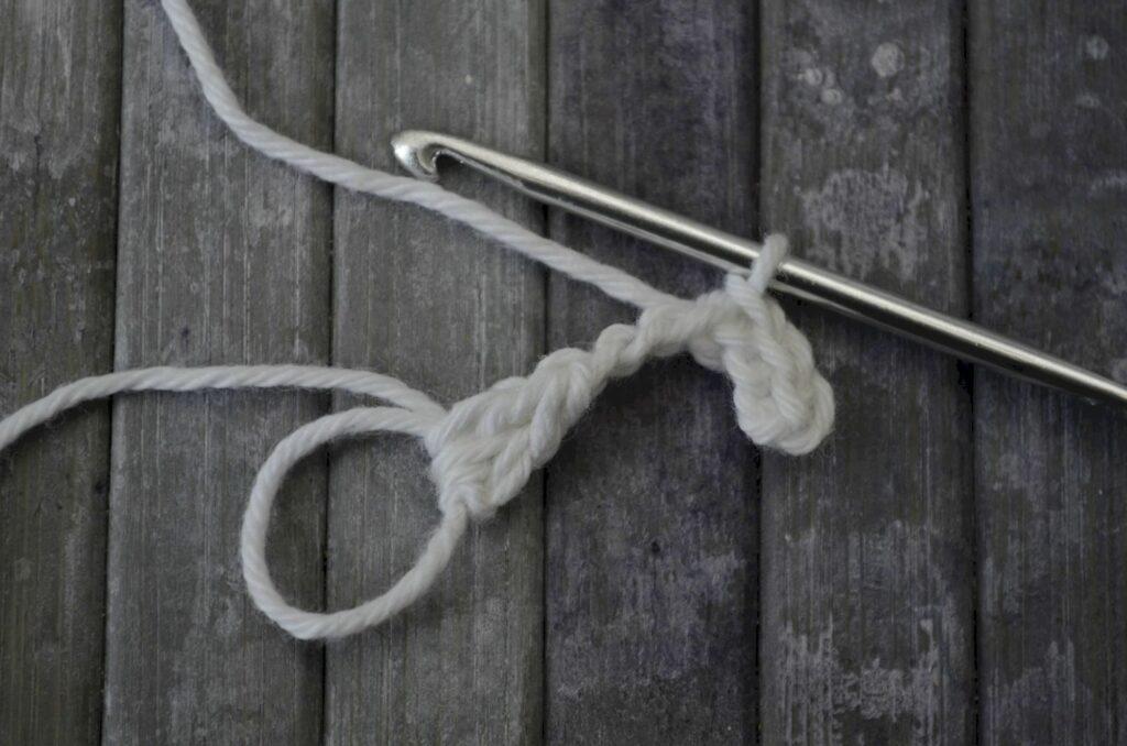 Easy snowflake crochet pattern yarnandy step 5