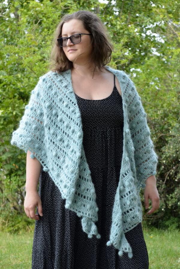 Mint truffle shawl being worn simply draped around the shoulders
