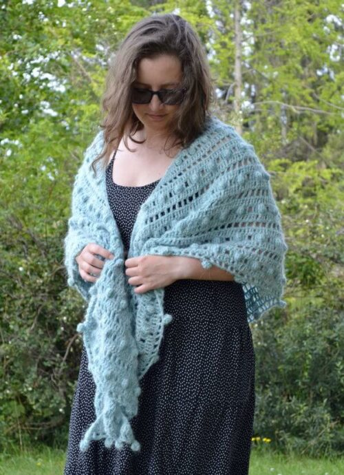 Mint truffle shawl being worn and gathered in front
