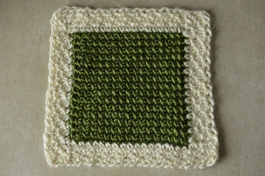 Reduce or remove Tunisian crochet curling by adding a non-curling border after the project is finished