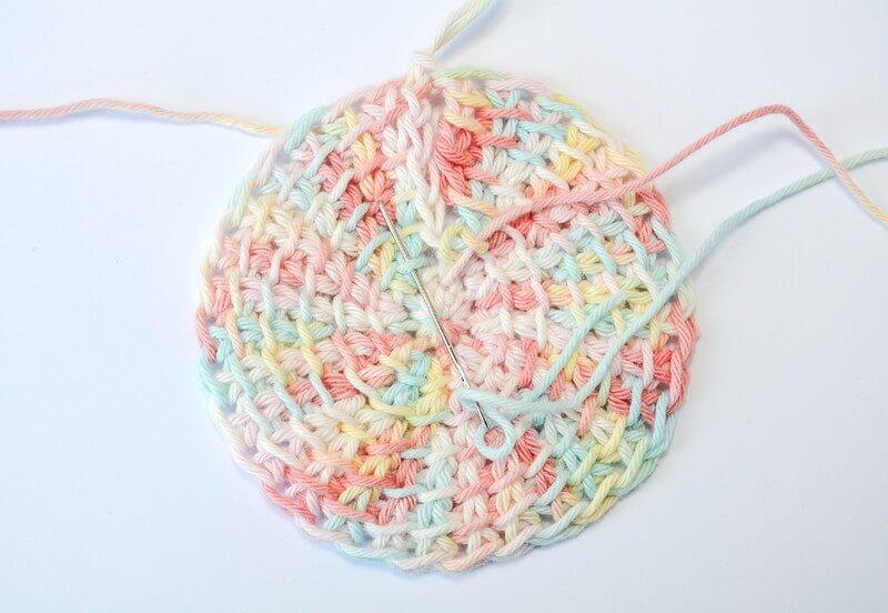 Tunisian crochet face scrubbies continuing the seam